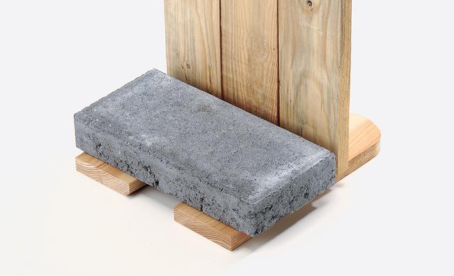 Fußplatte beschweren