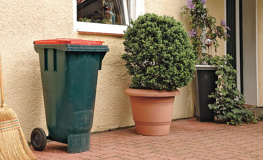 Grüne Mülltonnenverkleidung bauen