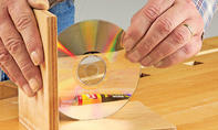 CD-Stützen: CD aufkleben
