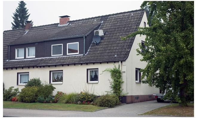 Haus mit schlecht gedämmten Fensterprofilen